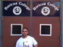 Walter Hidalgo underneath the doors of Boricua College
