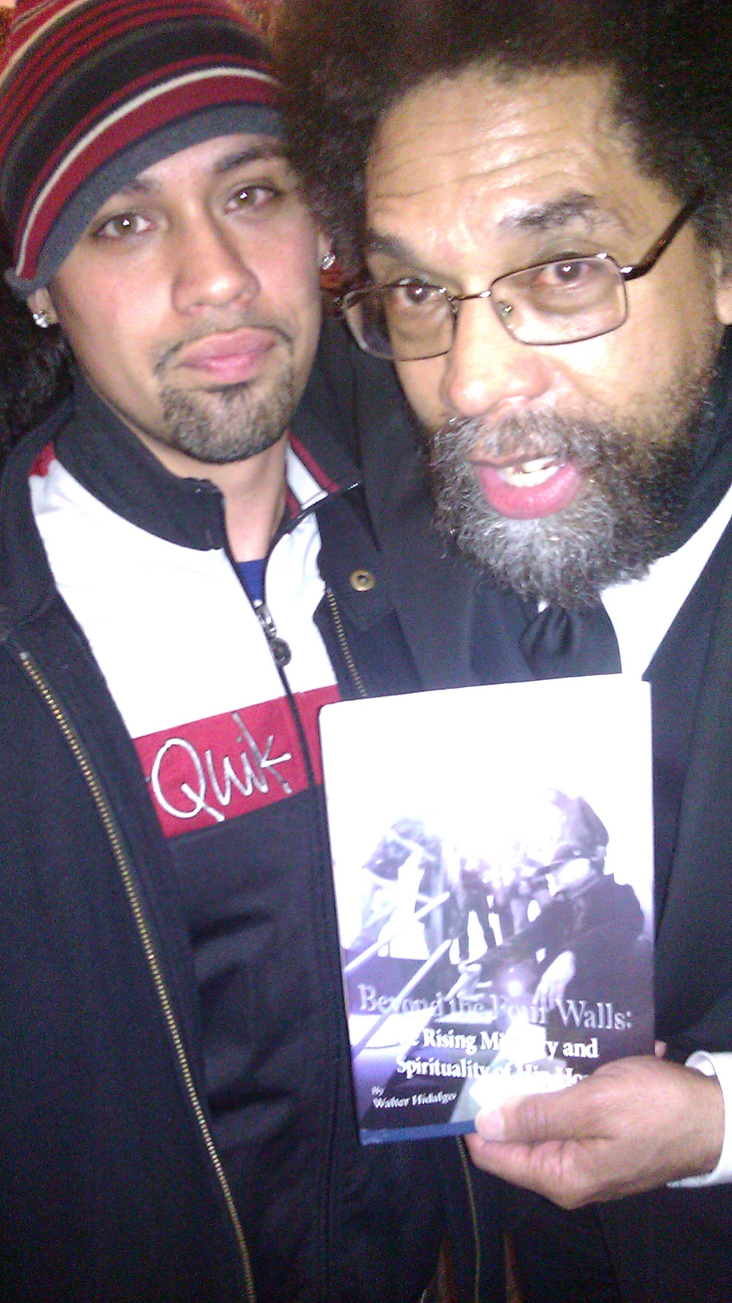 Dr. Cornel West takes a picture with Walter Hidalgo after receiving a signed copy of his book with much enthusiasm!