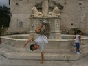 Daniel Choi, a youth of the Riverside Church in New York City, poses in front of the cathedral in old Havana, Cuba